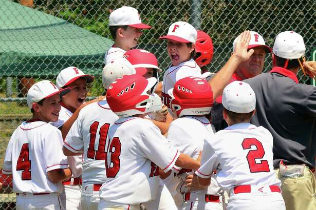 Fairfield American celebrates its win over Trumbull National in District 2 little league baseball action at Unity Park in Trumbull, Conn., on Saturday July 14, 2018.