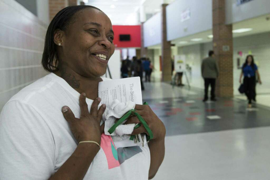 Keola Williams, left, is a smiles as she celebrates after having eight outstanding tickets reduced to two, during the Make It Right! program at North Shore High School on Saturday, July 14, 2018, in Houston. Make It Right! is designed to help members of the community, with low-level, non-violent misdemeanor offenses, have outstanding warrants removed and pending cases resolved with no immediate financial cost and no risk of arrest. ( Brett Coomer / Houston Chronicle ) Photo: Brett Coomer, Staff / Houston Chronicle / © 2018 Houston Chronicle