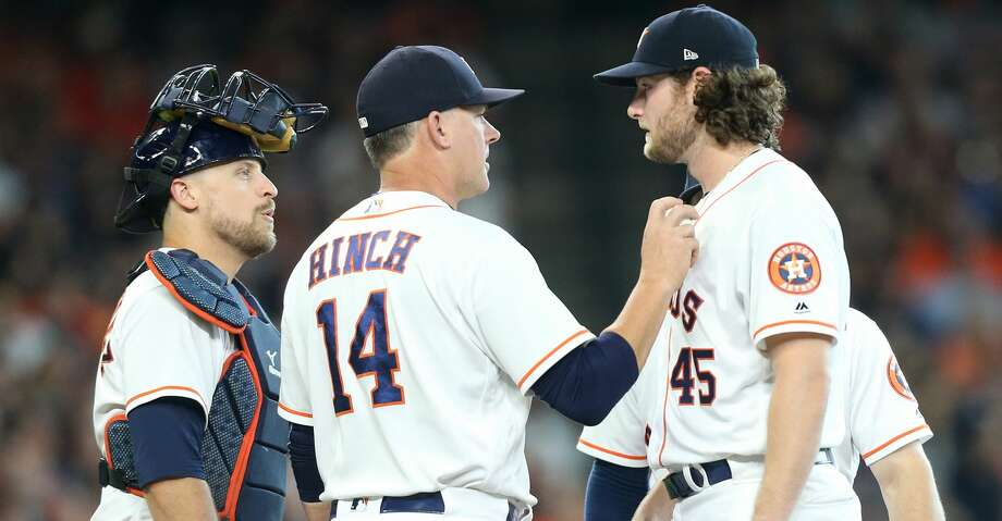 Houston Astros manager AJ Hinch (14) talks to Houston Astros starting pitcher Gerrit Cole (45) as he pulls him in the sixth inning on Saturday, July 14, 2018. Astros won the game 9-1 and lead the Tigers 2-0 in the series.( Elizabeth Conley / Houston Chronicle ) Photo: Elizabeth Conley/Houston Chronicle