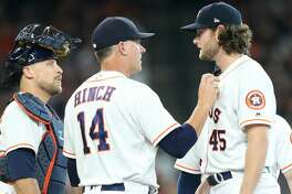 Houston Astros manager AJ Hinch (14) talks to Houston Astros starting pitcher Gerrit Cole (45) as he pulls him in the sixth inning on Saturday, July 14, 2018. Astros won the game 9-1 and lead the Tigers 2-0 in the series.( Elizabeth Conley / Houston Chronicle )