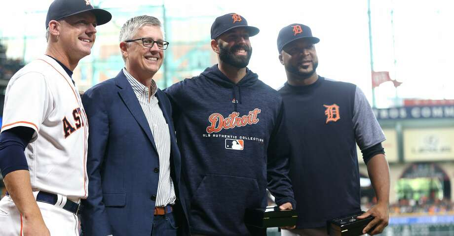 Houston Astros manager AJ Hinch, from left, poses with GM Jeff Luhnow and former Astros Mike Fiers  and Francisco Liriano after presenting the players with their World Series Championship rings at Minute Maid Park on Saturday, July 14, 2018. Astros won the game 9-1 and lead the Tigers 2-0 in the series.( Elizabeth Conley / Houston Chronicle ) Photo: Elizabeth Conley/Houston Chronicle
