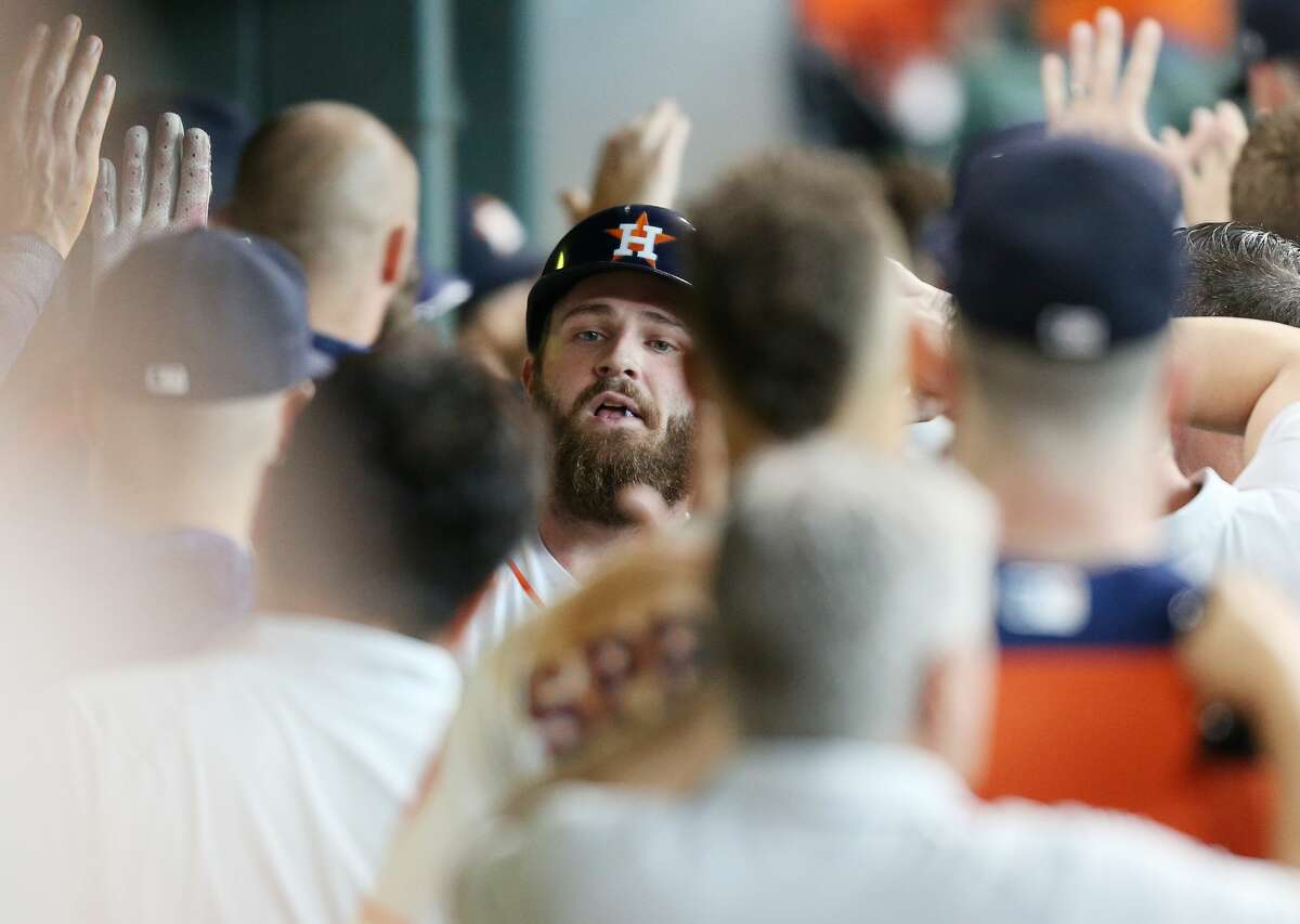 Houston Astros third baseman Tyler White (13) is congratulated after his two-run home run in the bottom of the seventh inning. Houston Astros host the Detroit Tigers at Minute Maid Park on Saturday, July 14, 2018. Astros won the game 9-1 and lead the Tigers 2-0 in the series.( Elizabeth Conley / Houston Chronicle )