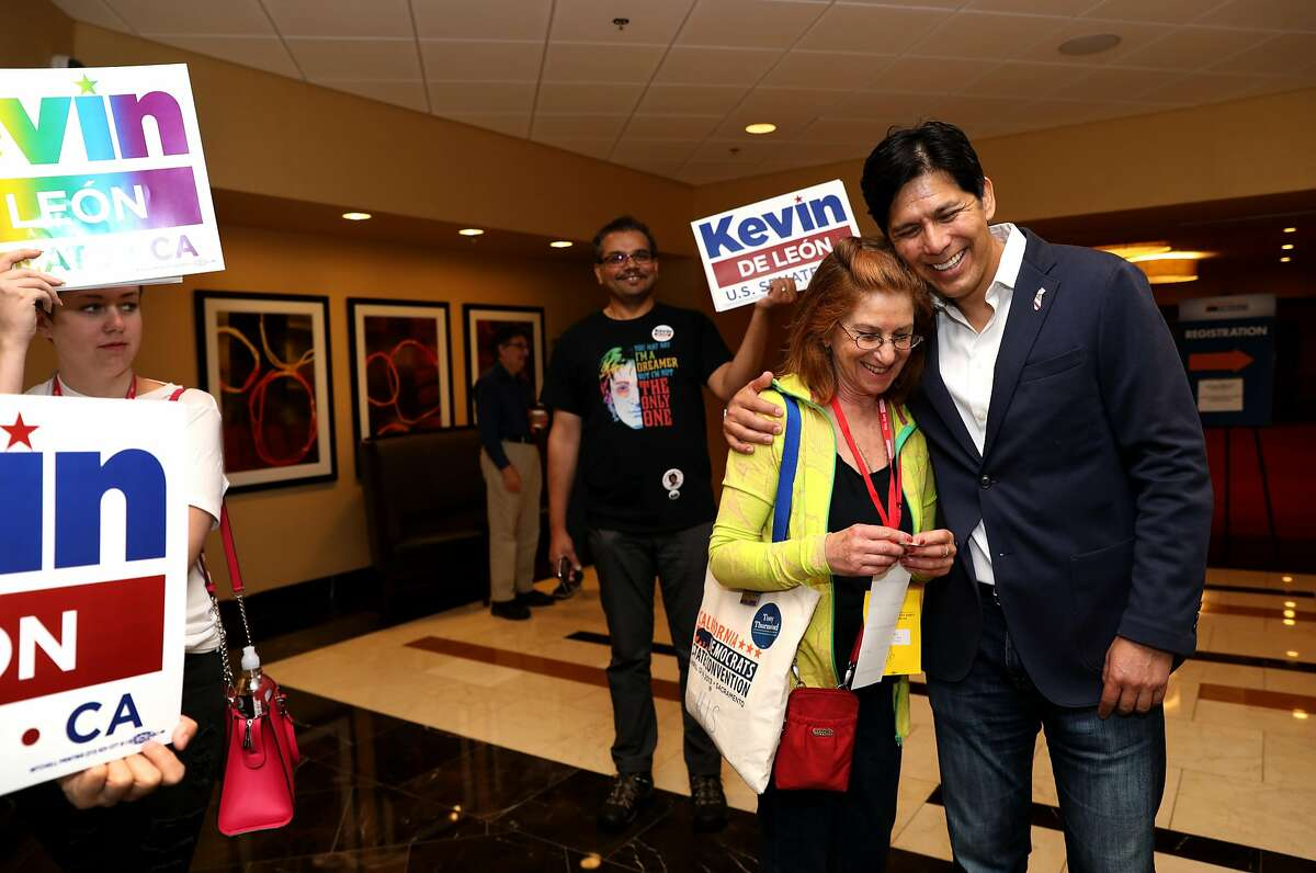 Helen J. Sizemore receives a hug from State Sen. Kevin de Leon, 51, during the 2018 Summer Executive Board Meeting, hosted by the California Democratic Party, at the Oakland Marriott City Center on Saturday, July 14, 2018, in Oakland, Cali.