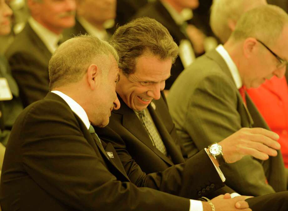 Governor Andrew Cuomo, right shares a laugh with Alain E. Kaloyeros senior vice president and chief executive officer, College of Nanoscale Science and Engineering at the College of Nanoscale Science and Engineering in Albany, N.Y. before the governors Tax-Free initiative presentation.    (Skip Dickstein/Times Union) Photo: Skip Dickstein / 00022671A