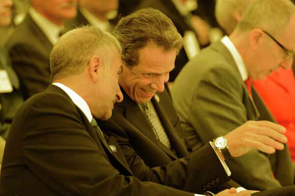 Governor Andrew Cuomo, right shares a laugh with Alain E. Kaloyeros senior vice president and chief executive officer, College of Nanoscale Science and Engineering at the College of Nanoscale Science and Engineering in Albany, N.Y. before the governors Tax-Free initiative presentation.    (Skip Dickstein/Times Union)