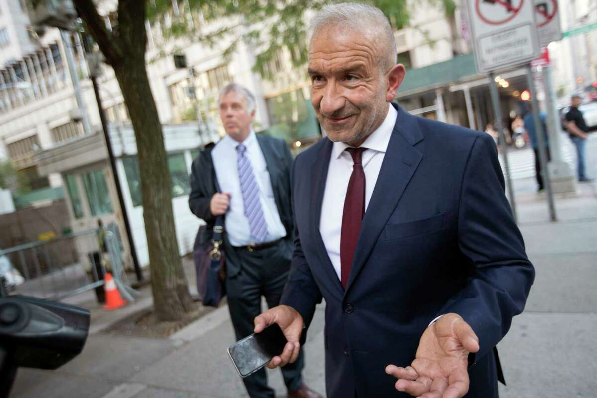 Alain Kaloyeros, foreground, leaves federal court in New York, Thursday, July 12, 2018. A federal jury has convicted Kaloyeros and three other defendants of corruption in Gov. Andrew Cuomo's