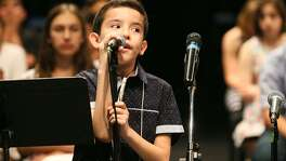 """Omar Lechuga, 10, a fifth-grader at Bellaire Elementary in San Antonio, correctly spells """"electorado"""" in the first round of the 2018 National Spanish Spelling Bee at at San Antonio College on July 14, 2018."""