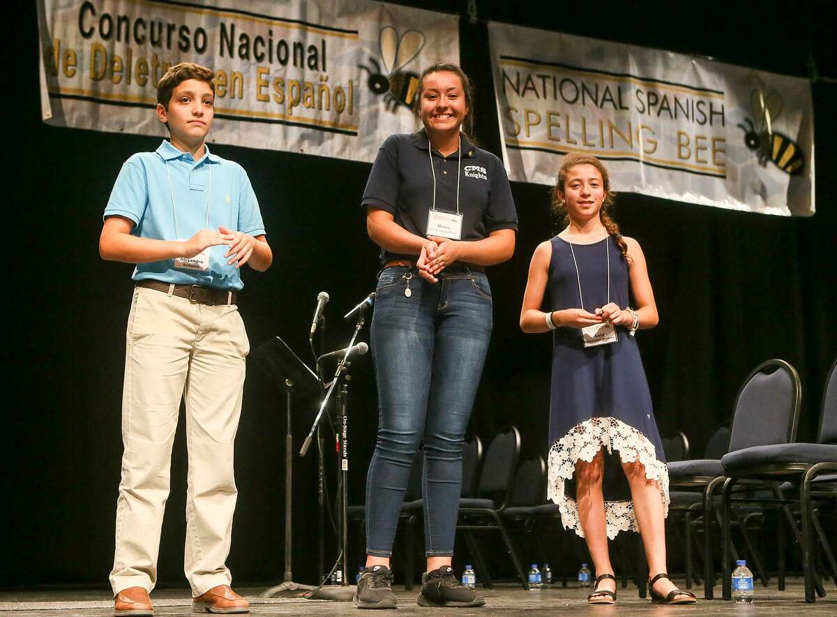 Defending champion Maria del Sol Nuez-Pea (center), 14, an eighth-grader at Chaparral Middle School in Chaparral, New Mexico, took first place in the 2018 National Spanish Spelling Bee at San Antonio College on July 14, 2018. Lola Hernandez Mendoza (right), 12, a seventh-grader at Spring Harbor Middle School in Madison, Wisconsin, took second, and Alejandro DeSantis, 12, a seventh-grader at St. Bonaventure Catholic School in Bonaventure, Florida, finisihed third.