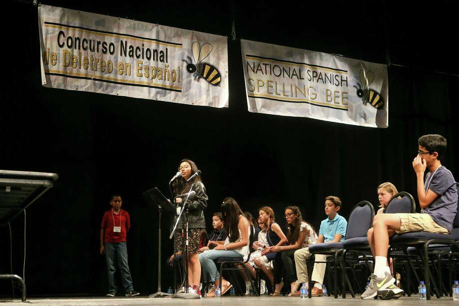 "Katherine Hernandez, representing North East Independent School District, correctly spells the word ""horcajadas"" in the ninth round of the 2018 National Spanish Spelling Bee at the McAllister Fine Arts Center at San Antonio College. Katherine, who immigrated El Salvador, now goes to MacArthur High School, which has a dual language program. / Express-News 2018"