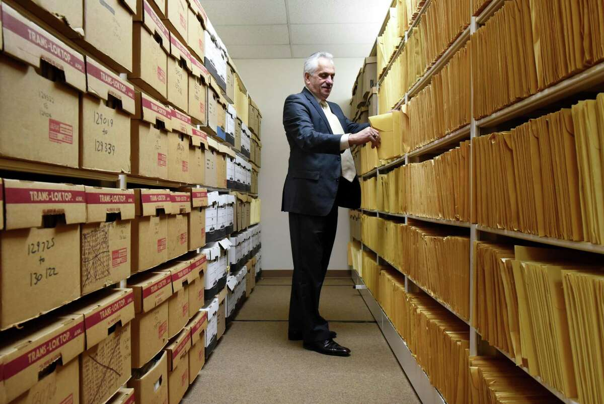Rensselaer County Clerk Frank Merola looks through records in county divorce paper storage aisle on Monday, March 19, 2018, at the Rensselaer County Clerk's Office in Troy, N.Y. (Will Waldron/Times Union)
