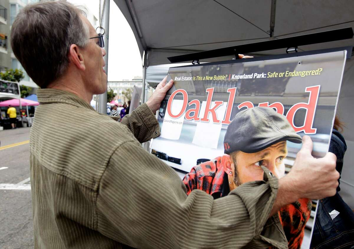 Publisher and co-owner Stephen Buel sets up his magazine's booth at the 14th annual Art and Soul Festival in Oakland, Calif. on Saturday, Aug. 2, 2014. The two-day music and arts street fair concludes Sunday.