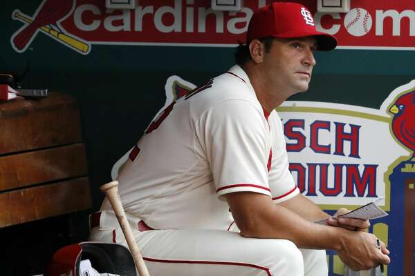 St. Louis Cardinals manager Mike Matheny sits in the dugout before the start of the fourth inning of a baseball game against the Cincinnati Reds, Saturday, July 14, 2018, in St. Louis. (AP Photo/Jeff Roberson)