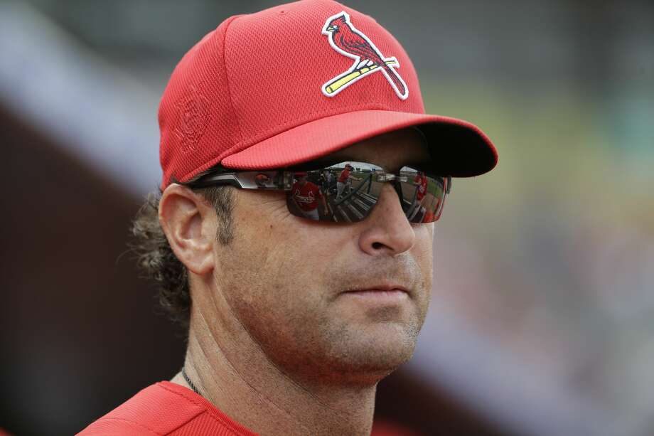 St. Louis Cardinals manager Mike Matheny  is seen in the dugout during an exhibition spring training baseball game against the Miami Marlins Saturday, March 5, 2016, in Jupiter, Fla. (AP Photo/Jeff Roberson) Photo: Jeff Roberson/AP
