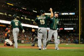Oakland Athletics Mark Canha (right) and A's Josh Phegley after a two run homer on Canha's pinch hit during the 7th inning of an MLB game between the San Francisco Giants and Oakland Athletics at AT&T Park on Saturday, July 14, 2018, in San Francisco, Calif.