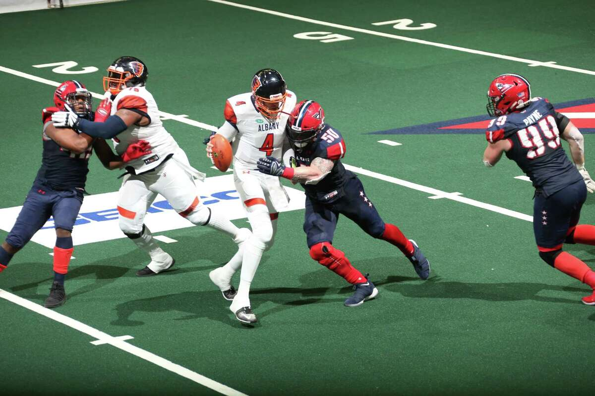 Albany quarterback Tommy Grady tries to escape the Washington defense in the Empire's 57-56 overtime win in the first round of the playoffs in Washington on Saturday, July 14, 2018. (Courtesy of Albany Empire)