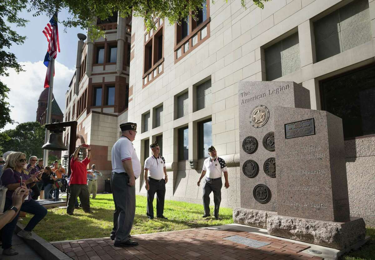 American Legion members Ricardo Castro (from right), Norman Mahan and Bill Gray look at the new American Legion monument after its unveiling on July 14, 2018, in front of the Cadena-Reeves Justice Center in downtown San Antonio.