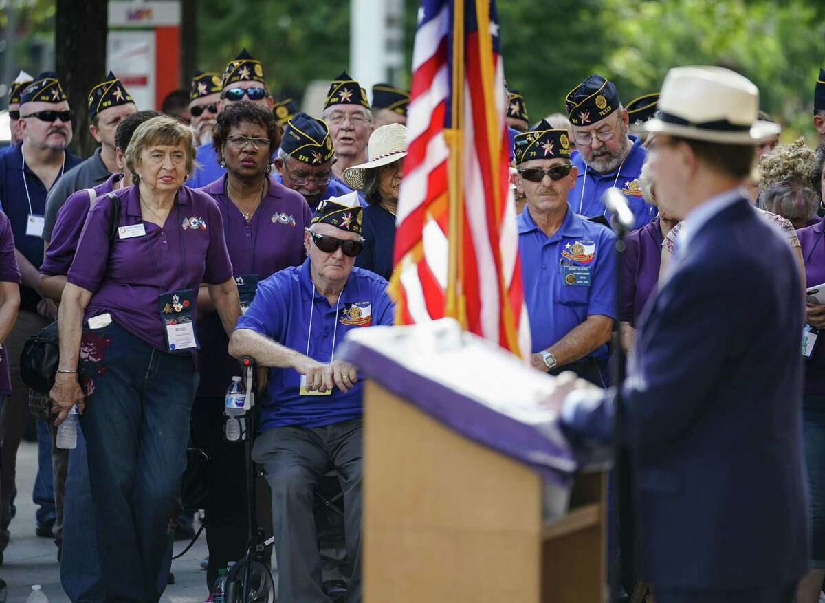 Attendees listen to Bexar County Judge Nelson W. Wolff speak during the unveiling ceremony of a new American Legion monument July 14, 2018.