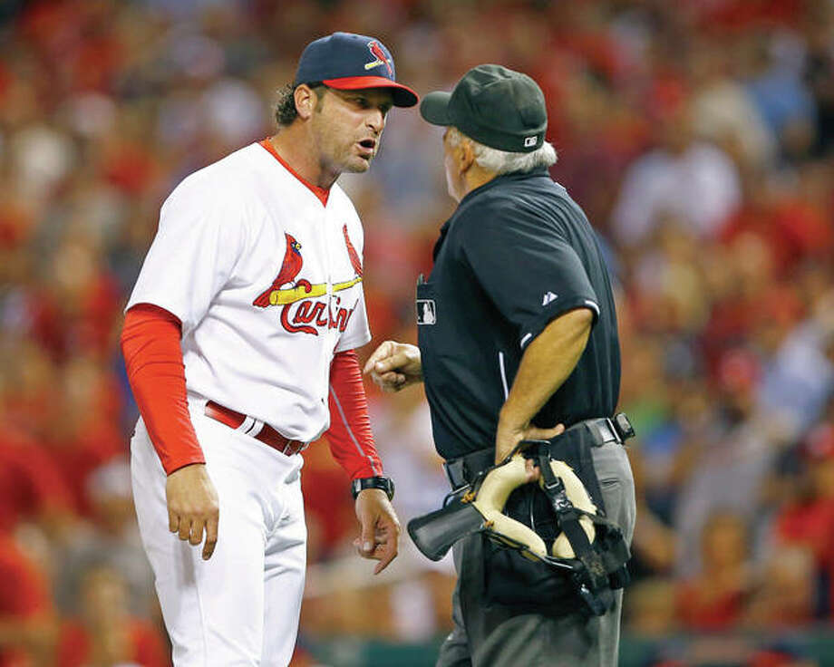 Cardinals manager Mike Matheny, left, and his team are under fire from fans who have grown accustomed to expecting more from the team than they feel they're getting these days.
