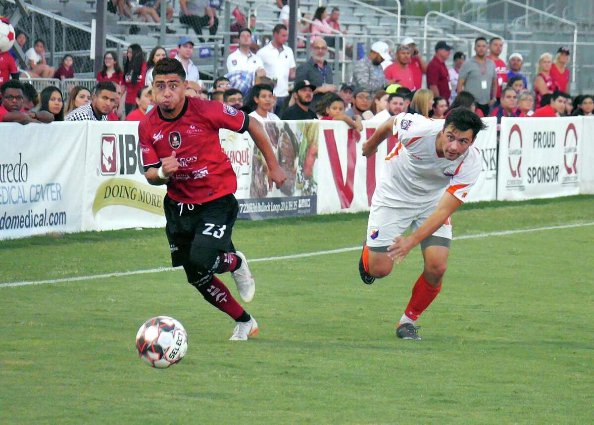 Laredo Heat midfielder Guillermo Diaz battles a Houston Dutch Lions player as they battled in the NPSL Lone Star Conference Championship game at the TAMIU Soccer Complex Saturday, July 14, 2018.