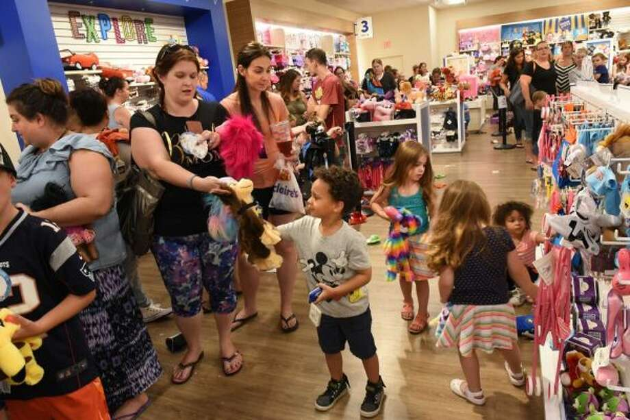"Children and parents wait in line at the Build-A-Bear Workshop at Crossgates Mall on Thursday, July 12, 2018 in Guilderland, N.Y. Today was the store's ""pay-your-age"" promotion. (Lori Van Buren/Times Union)"