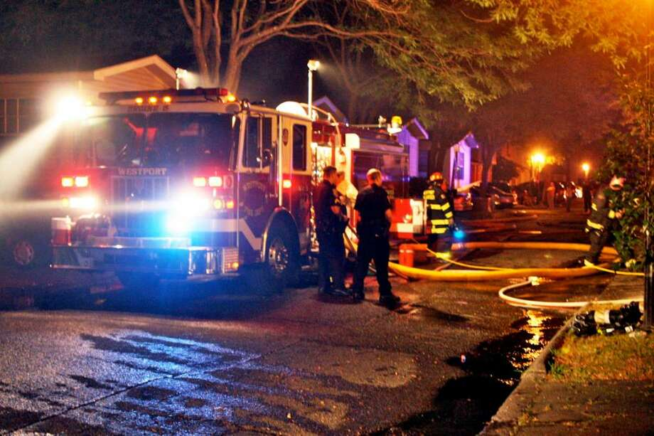 The Westport Fire department responded to a structure fire at the Sasco Creek Village trailer park, units # 86 and # 88, 1655 Post Road in Westport, Conn. on Wednesday July 7, 2010. The rear portions of both units, which were attached, were both heavily involved in fire. Two Fire Fighters were slightly injured during the fire and were transported to Norwalk Hospital for further evaluation. Photo: Contributed Photo / Connecticut Post Contributed