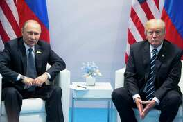FILE - In this July 7, 2017, file photo, U.S. President Donald Trump, right, and Russian President Vladimir Putin pose for a photo during the G20 summit in Hamburg Germany.