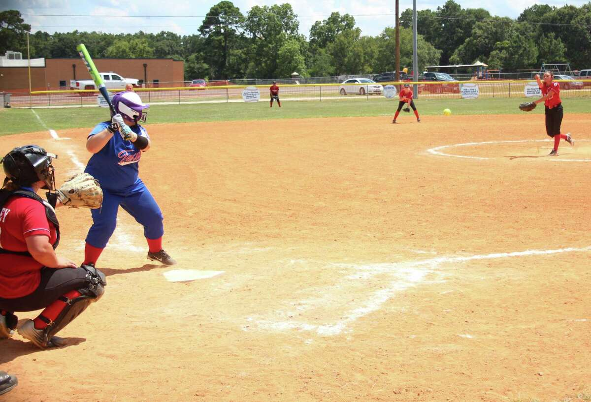 Victoria Ritchie (right) of the Coldspring Debs All-Stars softball team throws a fast pitch to a batter from the Tri-Cities Debs during the July 14 softball game.