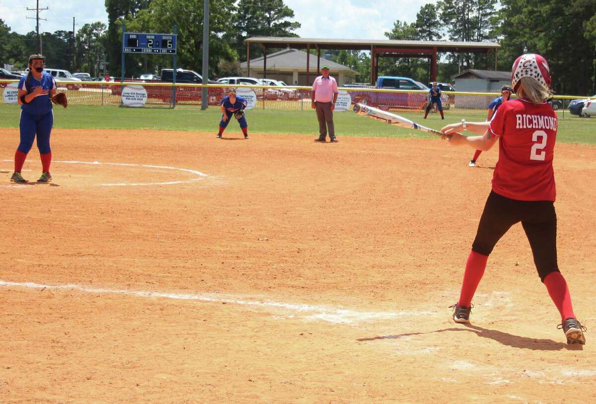 Kelsey Richmond (right) of the Coldspring Debs All-Stars knocks the ball far away during the All-Stars game against theTri-Cities Debs on July 14.
