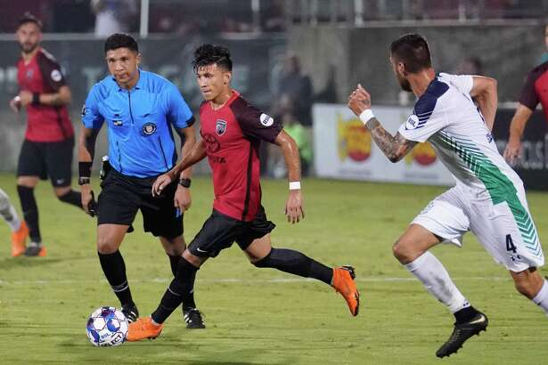 Mikey Lopez (with ball) and San Antonio FC remained winless in their past four road matches with Saturday's 3-0 loss against Orange County FC in Irvine, California. The local team is 0-2-2 during that span.