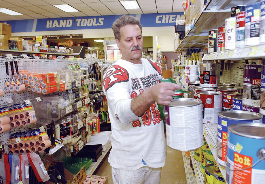 Contractor Ray Romano picks out some house paint for a job at Cromwell Hardware on Monday...................TW photo..........041304 Photo: Middletown Press File Photo