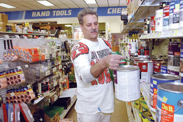 Contractor Ray Romano picks out some house paint for a job at Cromwell Hardware on Monday...................TW photo..........041304