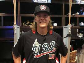 Shaun Anderson, a San Francisco Giants pitching prospect,�in front of�his locker at Nationals Park, site of the 2018 Futures Game.