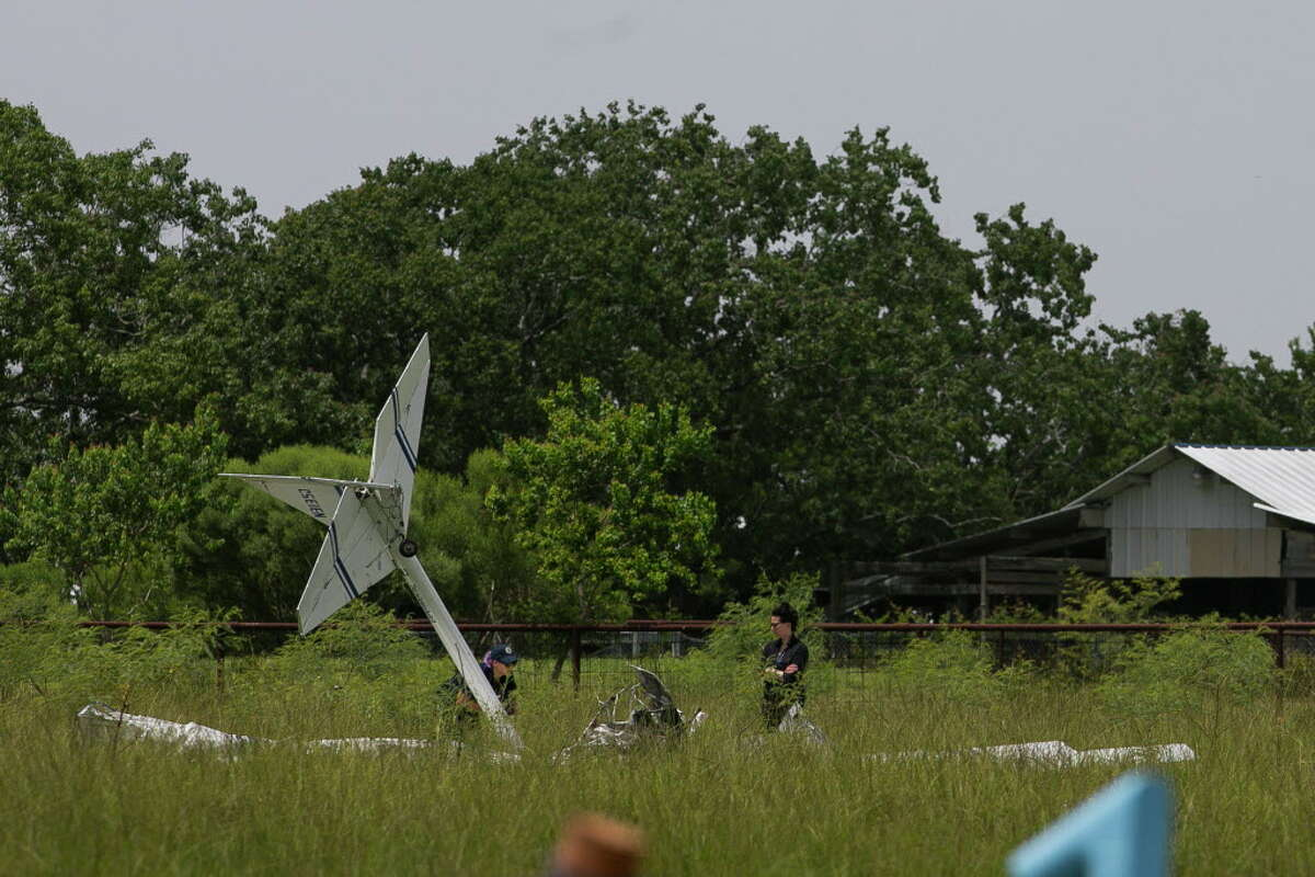 Investigators examine the site of a fatal plane crash that killed two people when the plane went down just north of the La Porte Municipal Airport,Sunday morning, July 15, 2018.An Experimental Kolb Twinstar II was heading into the north side of the La Porte Municipal Airport just before 10 a.m. when it went down about 300 yards from the end of the runway, according to the Federal Aviation Administration.