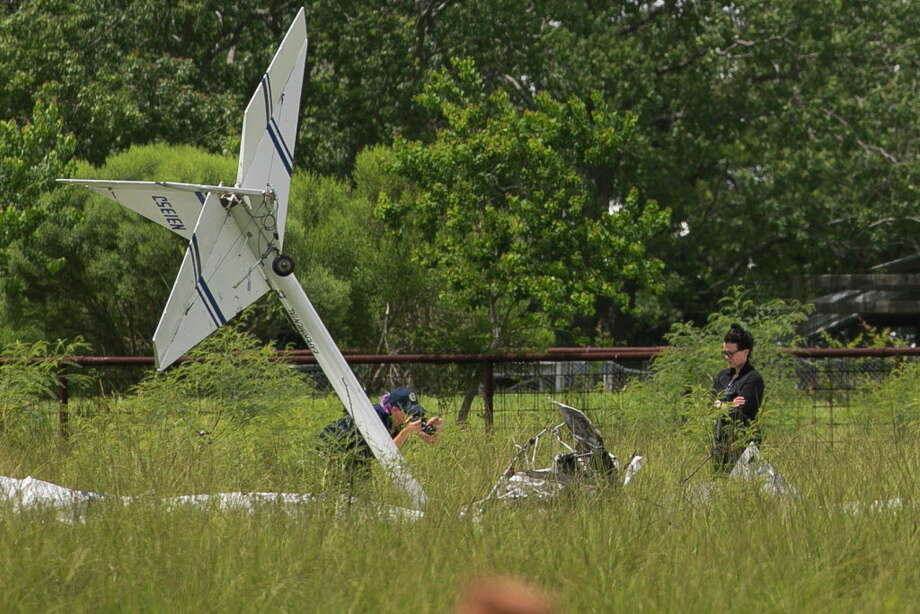 Investigators examine the site of a fatal plane crash that killed two people when the plane went down just north of the La Porte Municipal Airport, Sunday morning, July 15, 2018. An Experimental Kolb Twinstar II was heading into the north side of the La Porte Municipal Airport just before 10 a.m. when it went down about 300 yards from the end of the runway, according to the Federal Aviation Administration. Photo: Annie Mulligan, Freelance / © 2018 Annie Mulligan Houston Chronicle