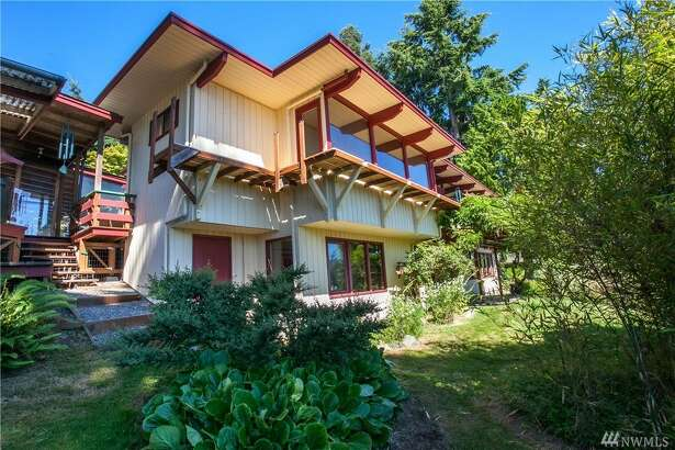 Vacation, retire, or just live in this custom 1969 mid-century cabin on Bainbridge Island for $725K.