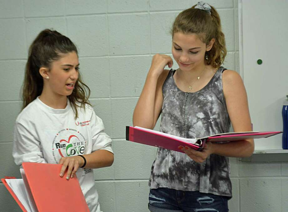 """From left, Makenzie Dunn (Caitlyn) and Julia Sciucco (lead character Mitchie), along with their fellow Cromwell Music Camp students, rehearse July 9 for """"Disney's Camp Rock The Musical"""" production, which will be staged July 27 to 28 at the high school. Photo: Cassandra Day / Hearst Connecticut Media"""