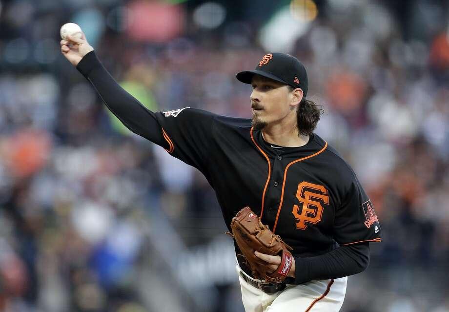 Jeff Samardzija throws in the first inning Saturday night. Photo: Marcio Jose Sanchez / Associated Press