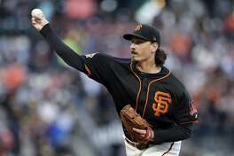 San Francisco Giants starting pitcher Jeff Samardzija throws to the Oakland Athletics during the first inning of a baseball game Saturday, July 14, 2018, in San Francisco. (AP Photo/Marcio Jose Sanchez)