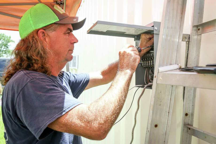 JR Harris, of Green Zone Housing and TQS Container Homes, completes some electrical work on a container home on Tuesday, July 10, 2018, in Willis. Photo: Michael Minasi, Staff Photographer / Houston Chronicle / © 2018 Houston Chronicle