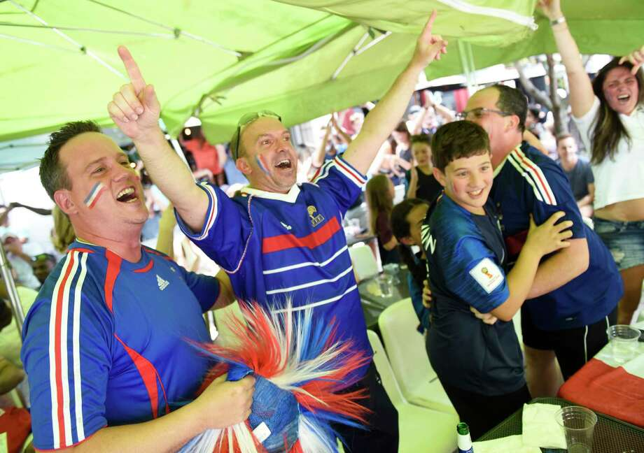 France fans, from left, Stephane Beal, of Norwalk, Stephane Mazet, of Port Chester, N.Y., Leo Charbonneau, 12, Nicolas Charbonneau, of Yonkers, N.Y., and Yekaterina Grewal, of Stamford, celebrate as time expires in France's 4-2 win over Croatia in the FIFA World Cup final viewing party outside of Capriccio Cafe in Stamford, Conn. Sunday, July 15, 2018. Enthustiastic fans flocked to the bars to watch as France beat Croatia 4-2 to win its second World Cup. Photo: Tyler Sizemore, Hearst Connecticut Media / Greenwich Time