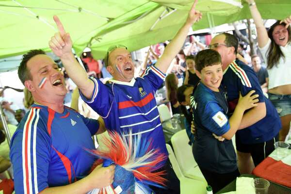 France fans, from left, Stephane Beal, of Norwalk, Stephane Mazet, of Port Chester, N.Y., Leo Charbonneau, 12, Nicolas Charbonneau, of Yonkers, N.Y., and Yekaterina Grewal, of Stamford, celebrate as time expires in France's 4-2 win over Croatia in the FIFA World Cup final viewing party outside of Capriccio Cafe in Stamford, Conn. Sunday, July 15, 2018. Enthustiastic fans flocked to the bars to watch as France beat Croatia 4-2 to win its second World Cup.
