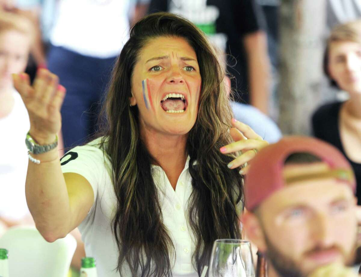 Yekaterina Grewal, of Stamford, cheers during France's 4-2 win over Croatia in the FIFA World Cup final viewing party outside of Capriccio Cafe in Stamford, Conn. Sunday, July 15, 2018. Enthustiastic fans flocked to the bars to watch as France beat Croatia 4-2 to win its second World Cup.