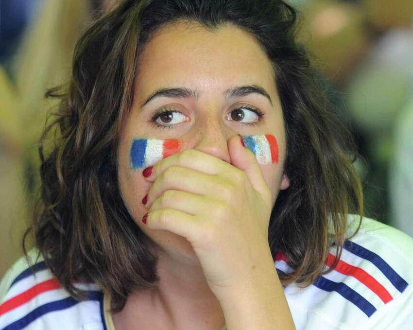 Andrea Menchero, of Brooklyn, N.Y., anxiously watches France's 4-2 win over Croatia in the FIFA World Cup final viewing party outside of Capriccio Cafe in Stamford, Conn. Sunday, July 15, 2018. Enthustiastic fans flocked to the bars to watch as France beat Croatia 4-2 to win its second World Cup.
