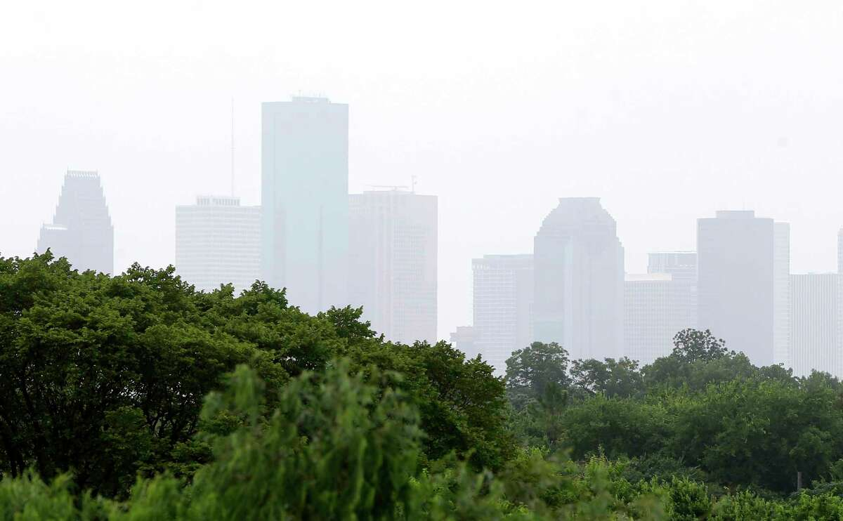 The hazy skyline of downtown is shown from I-45 near 610 Sunday, July 15, 2018, in Houston. The African dust travels from the Sahara desert and will contribute to low air quality over the next few days.