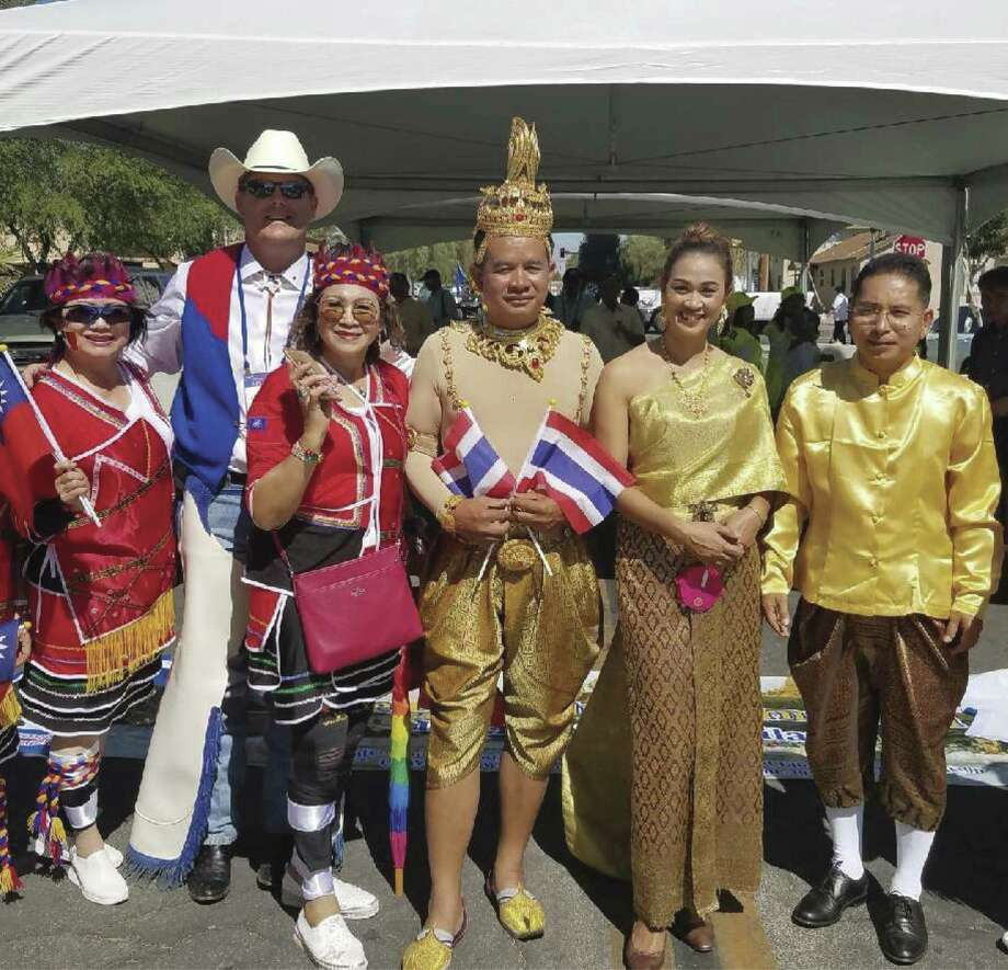 Conroe Noon Lions club president Bobby Brennan (second from left) visits with the Thailand delegation during the Lions Clubs International Convention Parade in Las Vegas last week.