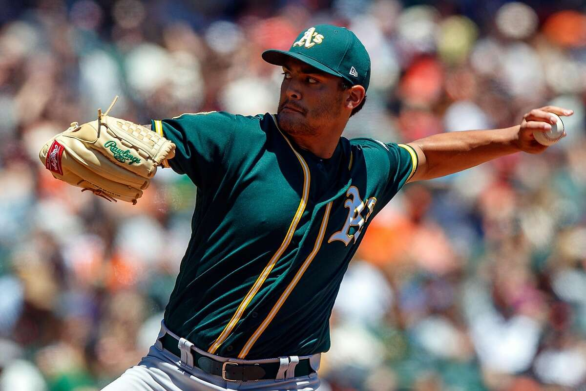 SAN FRANCISCO, CA - JULY 15: Sean Manaea #55 of the Oakland Athletics pitches against the San Francisco Giants during the first inning at AT&T Park on July 15, 2018 in San Francisco, California. (Photo by Jason O. Watson/Getty Images)