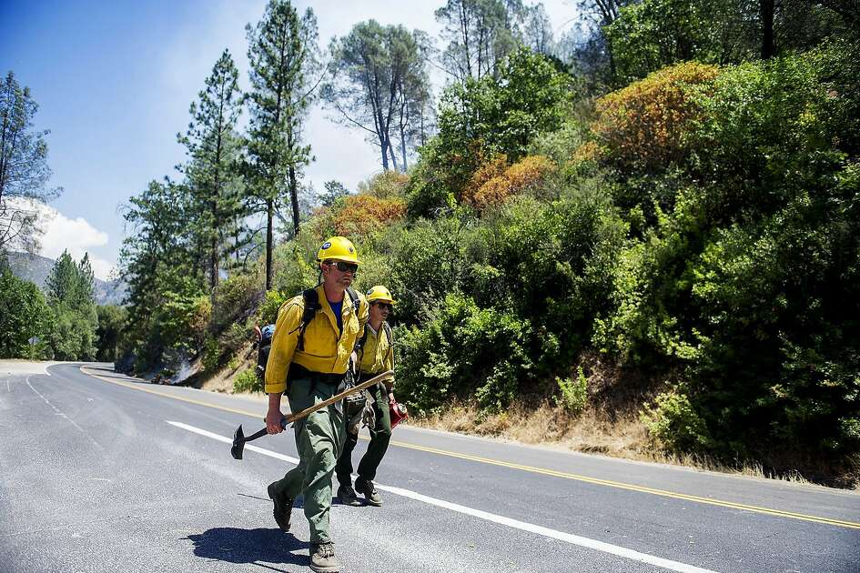 Kern County firefighters make their way to the Redbud Lodge to fight the Ferguson Fire along Highway 140 near El Portal in Mariposa County, Calif., on Saturday, July 14, 2018. (Andrew Kuhn /The Merced Sun-Star via AP)