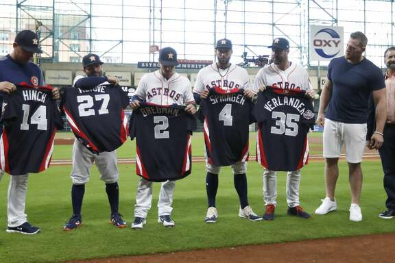 Houston Texand J.J. Watt with A.J. Hinch, Jose Altuve, Alex Bregman, George Springer and Justin Verlander as he handed out All-Star jerseys before the start of an MLB game at Minute Maid Park, Thursday, July 12, 2018, in Houston. ( Karen Warren  / Houston Chronicle )