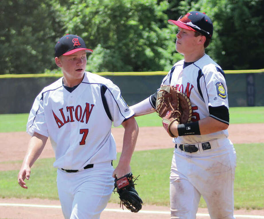 Alton Legion Post 126 first baseman Adam Stilts (right) acknowledges pitcher Zach Knight after getting the final out of an inning against Jefferson City (Mo.) on June 10 in Ballwin, Missouri. Alton opens the District 22 Tournament on Monday at home. Photo:       Greg Shashack / The Telegraph