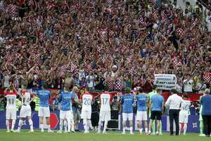 Croatian players acknowledge the applause of their supporters after losing to France in the World Cup final on Sunday.